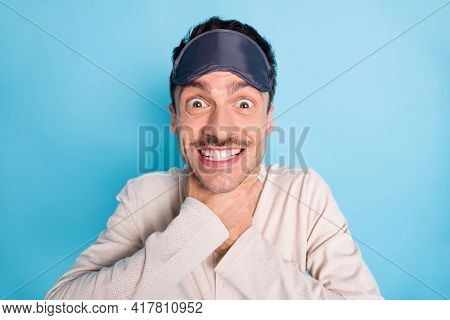 Portrait Of Nice Cheerful Funny Brunet Guy Wearing Sleep Mask Choking Neck Having Fun Isolated Over