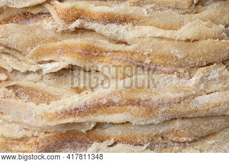 Dried and salted cod full frame close up  as background