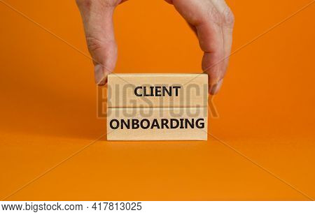 Client Onboarding Success Symbol. Wooden Blocks With Words 'client Onboarding' On Beautiful Orange B