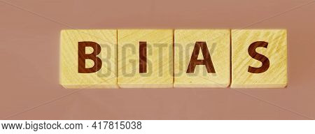 The Word Bias On Wooden Blocks Blue Background.