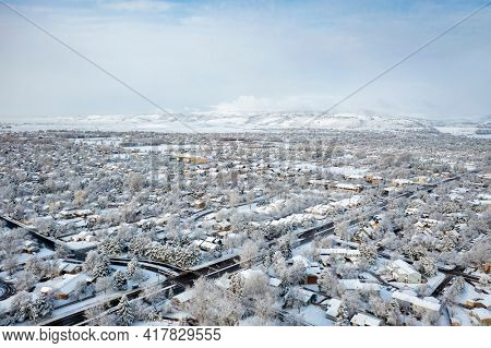 residential area of Fort Collins in northern Colorado after springtime snowstorm, aerial view