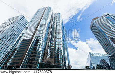 Urban Skyline With Perspective View Of Modern Commercial Skyscrapers, High-rise Office Buildings In