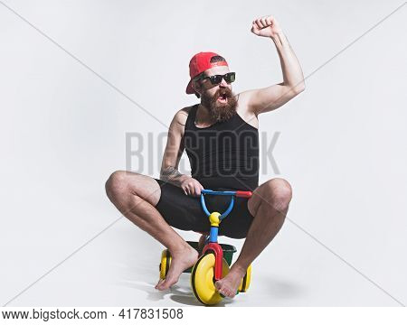Amazed Funny Bicycle Rider, Excited Man On Colorful Bicycle Toy In Sunglasses, Cap. Guy Riding Child