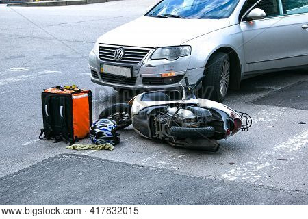 Dnepropetrovsk, Ukraine - 04.21.2021: Helmet And Motorcycle After A Dangerous Road Traffic Accident