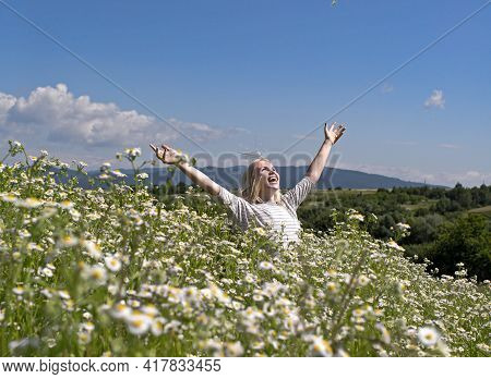 Sensual Woman In Blossoming Flower Field, Spring. Womens Day, Mothers Day, Beauty. Spring, Woman In