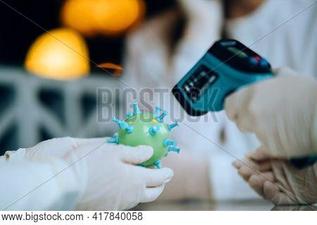 Scientist Virologist Holding Model Of New Coronavirus Or Covid-19