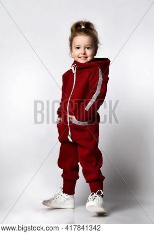 Cute Charming Little Preschooler Girl With European Appearance Wearing Trendy Fashion Tracksuit Spor
