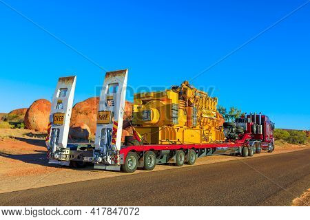 Northern Territory, Australia - August 12, 2019: Red Kenworth Truck Of Clein Group Crossing The Karl