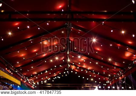 Top Of The Canopy In A Red Textile Gazebo With String Light Garlands Decorative Holiday Lighting Roo