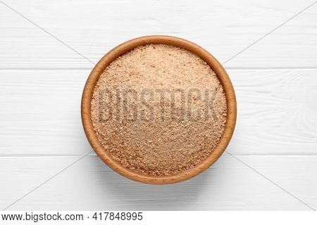 Fresh Breadcrumbs In Bowl On White Wooden Table, Top View