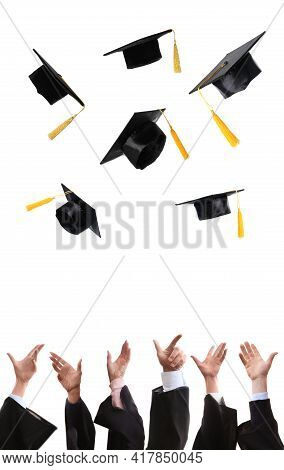 Group Of Graduates Throwing Hats Against White Background, Closeup. Vertical Banner Design