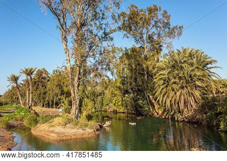 The Jordan River is the most famous river in the world. Jordan in Yardenit, where Christian pilgrims usually dive into the river. Wonderful walk along the river. The winter sunny day. Israel