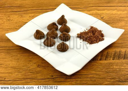 Cocoa Dusted Chocolate Truffles With Cocoa Powder On White Snack Plate On Table