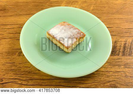 Custard Cream Cortadillo Cake On Green Dessert Plate On Table