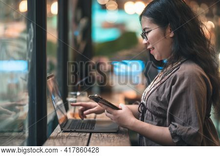 Happy Of Asian Freelance People Businesswoman Writing Message On Smartphone Casual Working With Lapt