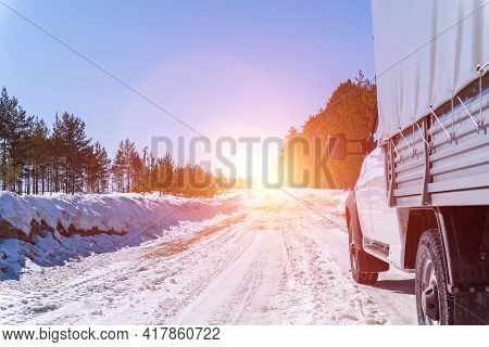 White Car On A Winter Road Through A Snow Covered Forest. Bottom View. Car On Winter Snowy Road In M