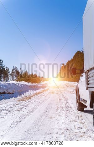 Car On A Winter Road. Adventure. Car On Winter Snowy Road In Mountains In Sunny Day. Vertical Photo