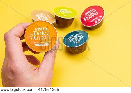 Tyumen, Russia-december 10, 2020: Nescafe Dolce Gusto Latte Macchiato. Coffee At Home. On A Yellow B