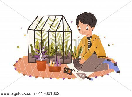 Boy Growing Green Plants In Pots And Care About Kitchen-garden. Happy Smiling Child And His Greenhou