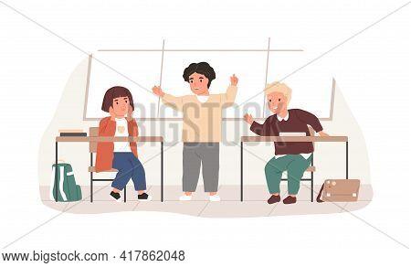 School Children Talking In Classroom During Break. Boy Telling Story To His Friends. Happy Schoolchi