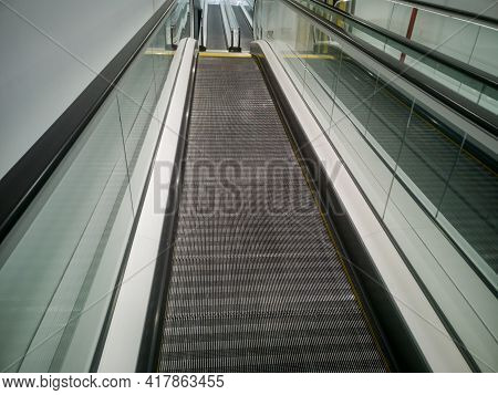 Escalator Stairs In A Shopping Center On The Rise To The Top