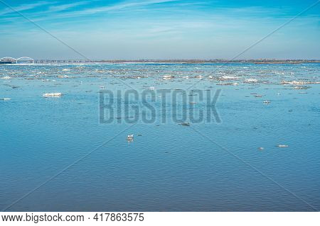 Ice Drift On The River. Ice Drift On A River With Blue High Water And Big Wate. Flood, High Water In