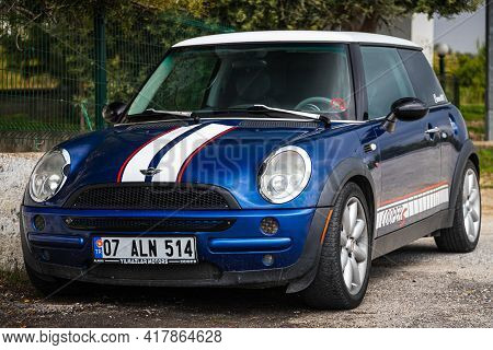 Alanya, Turkey - April 12 2021:   Blue Mini Cooper S Parked On The Street On A Warm Summer Day Again