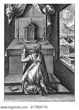 A praying man kneels before an altar. Next to him is a book and on the altar is a tabernacle, flanked by two candles.