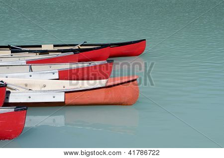 Canoes On Emerald Lake