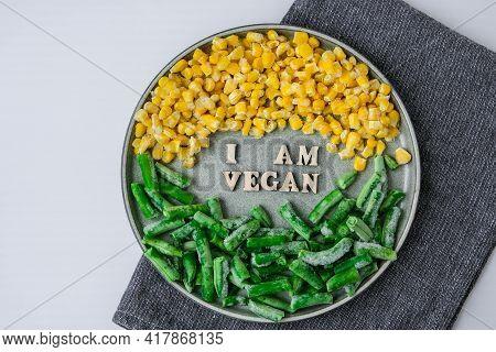 I Am Vegan Text In Plate. Veganism, Vegetarian Healthy Lifestyle Green Beans Yellow Corn. Healthy Ea