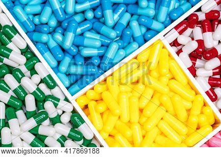 Top View Colorful Antibiotic Capsule Pills In Plastic Box. Antibiotic Drug Resistance Concept. Drug