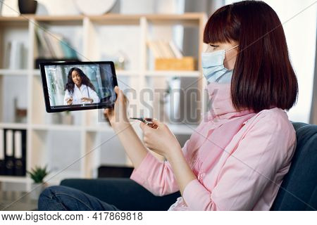 Online Medicine. Remote Consultation Of The Doctor. Sick Woman In Mask With Coronavirus Symptoms And