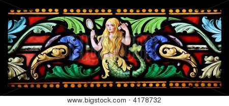 Stained glass window in St.Sulpice church Fougeres France depicting a beautiful blonde mermaid. poster