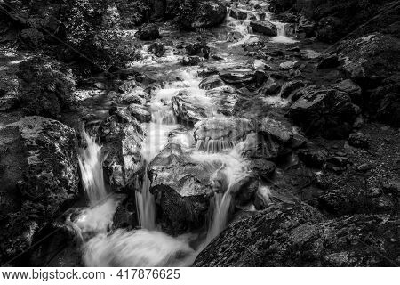 Fine Art Photography Of Shallow River Water Splashing And Falling Over Rocky Riverbed In Scenic New