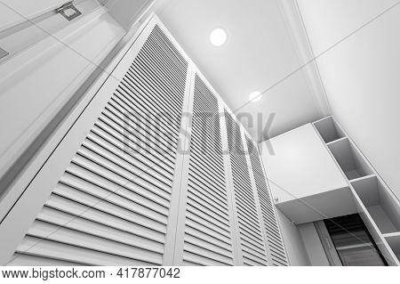 White laundry space inside wardobe room in new luxury apartment