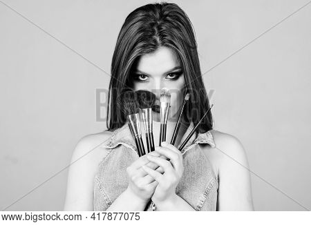 Cool And Sexy. Sensual Woman With Long Hair, Style. Sexy Woman With Professional Make Up Brush. Fash