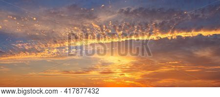 Dramatic Colorful Red Orange To Dark Blue Sunset Or Sunrise Sky Landscape Clouds. Natural Beautiful