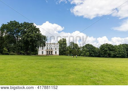 Hamburg, Germany – July 7, 2020: Jenischpark, public park at Hamburg, with Jenisch House, a classicist villa today acting as a museum and exhibition hall.