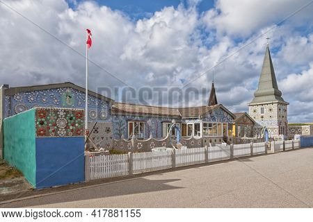 Thyborøn, Denmark – September 5, 2020: Sneglehuset, a house covered with snail shells and seashells, today a museum.