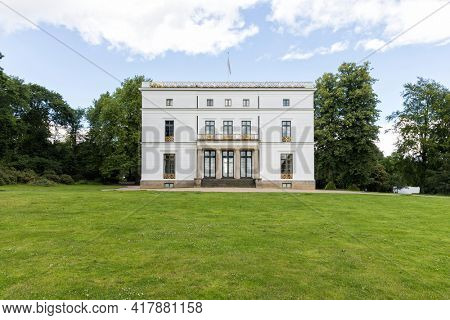 Hamburg, Germany – July 7, 2020: Jenisch House, a classicist villa today acting as an exhibition hall and museum, at Jenischpark, public garden in Hamburg