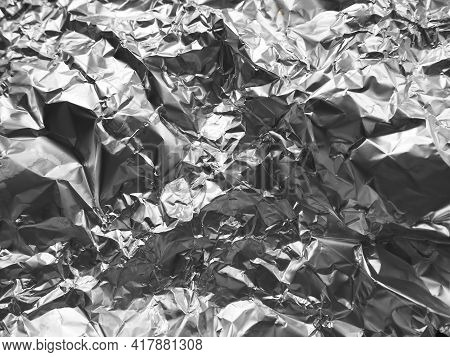 Foil Close-up. Aluminum Silver Crumpled Foil. Abstract Metallic Background. Foil For Baking Food. Ba