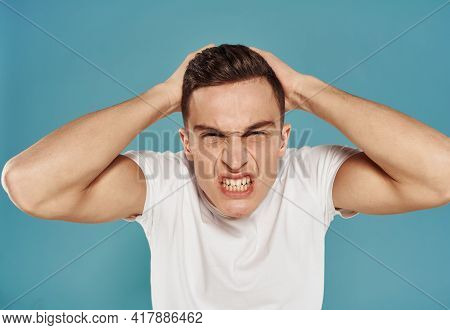 Angry Man In White T-shirt Gesture With Hands Displeasure Blue Background