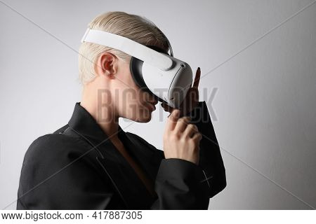 Young Woman With Blonde Hair Wearing Vr Glasses. Isolated.