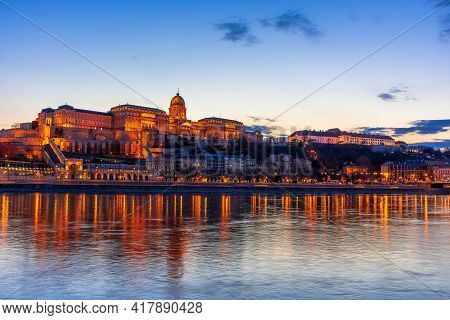 Hungary, Budapest At Night, Buda Fortress Illuminated By Lights, Reflected In The Water