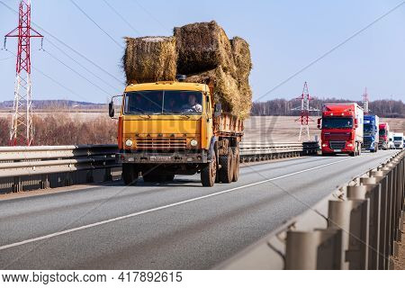 Tatarstan, Russia, Interstate Highway M7  - Apr 14th 2021. Truck Kamaz With Sheaves Of Hay Move Alon