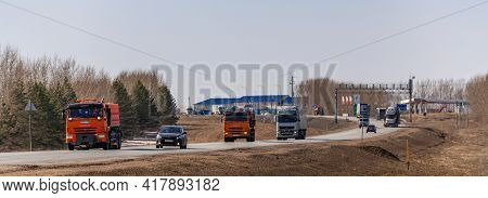 Tatarstan, Russia, Interstate Highway M7  - Apr 14th 2021. Several Truck Move Along The Federal High