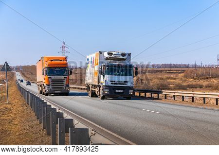 Tatarstan, Russia, Interstate Highway M7  - Apr 14th 2021. The Iveco Truck Overtakes The Scania Truc