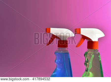Detergent Spray Cleaner On Purple Background. Detergents For Washing Windows And Cleaning Dishes. Co