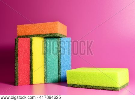 Sponge For Washing Dishes And Plumbing On A Purple Background. Detergents For Kitchen For Cleaning,