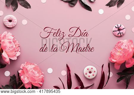 Feliz Dia De La Madre Means Happy Mothers Day In Spanish. Pink Peony Flowers, Leaves And Sweet Dough